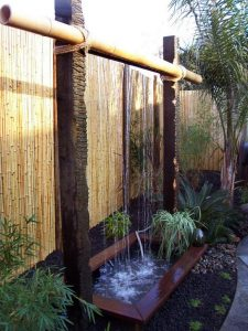 15 Relaxing Backyard Waterfalls Ideas For Your Outdoor 04