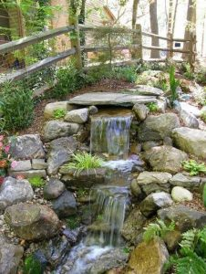 15 Relaxing Backyard Waterfalls Ideas For Your Outdoor 13