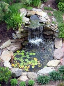 15 Relaxing Backyard Waterfalls Ideas For Your Outdoor 17